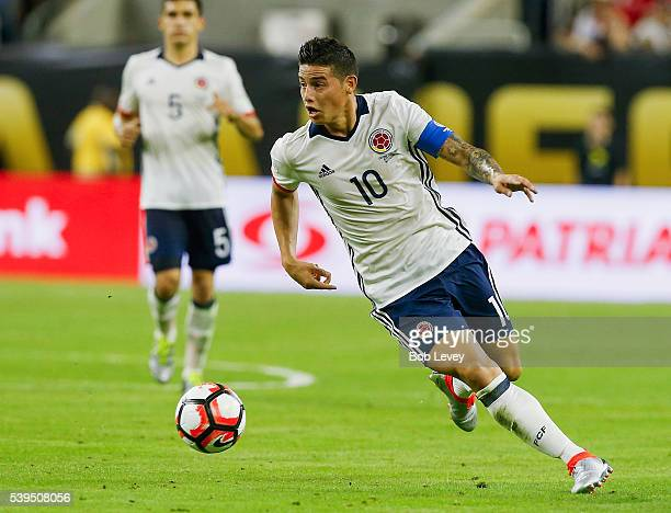 James Rodriguez of Colombia brings the ball up the field in the second half against Costa Rica at NRG Stadium on June 11 2016 in Houston Texas
