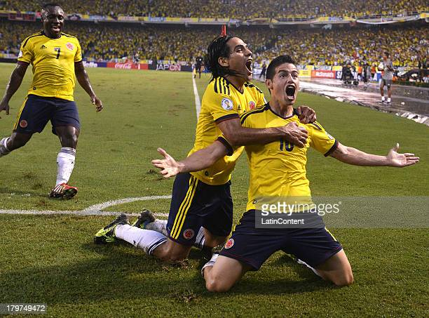James Rodriguez of Colombia celebrates a goal with his teammates during a match between Colombia and Ecuador as part of the 15th round of the South...