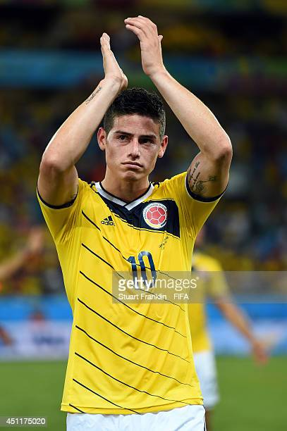 James Rodriguez of Colombia celebrates after the 2014 FIFA World Cup Brazil Group C match between Japan and Colombia at Arena Pantanal on June 24...