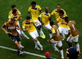 James Rodriguez of Colombia celebrates by dancing with teammates after scoring his team's first goal during the 2014 FIFA World Cup Brazil Group C...