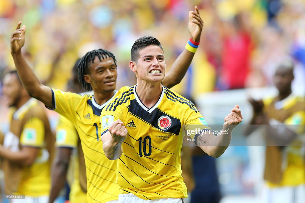 <a gi-track='captionPersonalityLinkClicked' href=/galleries/search?phrase=James+Rodriguez&family=editorial&specificpeople=4422074 ng-click='$event.stopPropagation()'>James Rodriguez</a> of Colombia celebrates scoring his team's first goal during the 2014 FIFA World Cup Brazil Group C match between Colombia and Cote D'Ivoire at Estadio Nacional on June 19, 2014 in Brasilia, Brazil.
