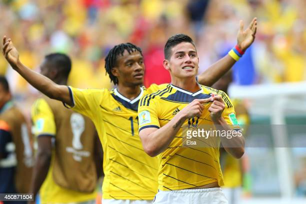 James Rodriguez of Colombia celebrates scoring his team's first goal during the 2014 FIFA World Cup Brazil Group C match between Colombia and Cote...