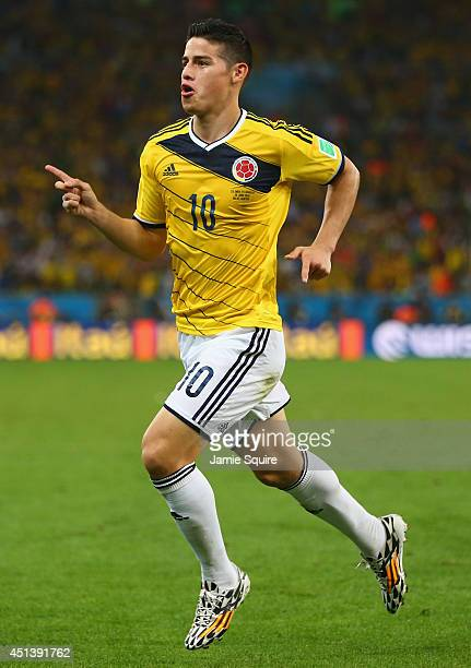 James Rodriguez of Colombia celebrates scoring his team's first goal during the 2014 FIFA World Cup Brazil round of 16 match between Colombia and...
