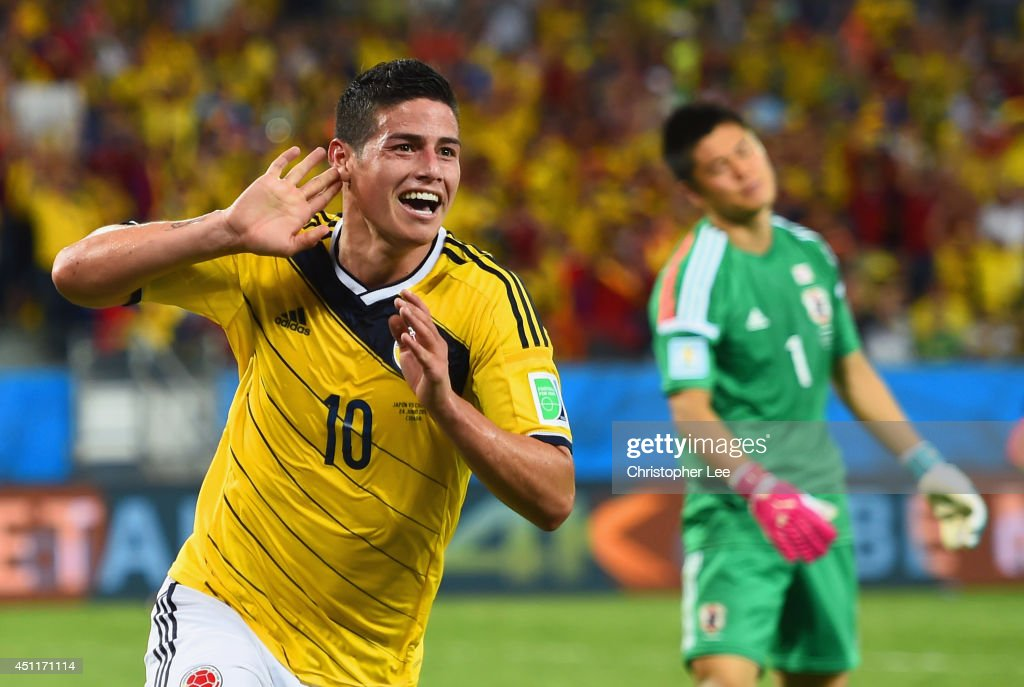 <a gi-track='captionPersonalityLinkClicked' href=/galleries/search?phrase=James+Rodriguez&family=editorial&specificpeople=4422074 ng-click='$event.stopPropagation()'>James Rodriguez</a> of Colombia celebrates scoring his team's fourth goal past goalkeeper <a gi-track='captionPersonalityLinkClicked' href=/galleries/search?phrase=Eiji+Kawashima&family=editorial&specificpeople=3117136 ng-click='$event.stopPropagation()'>Eiji Kawashima</a> of Japan during the 2014 FIFA World Cup Brazil Group C match between Japan and Colombia at Arena Pantanal on June 24, 2014 in Cuiaba, Brazil.