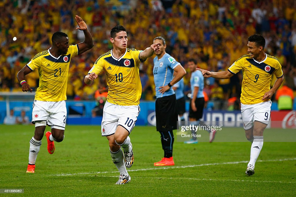James Rodriguez of Colombia (C) celebrates scoring his team's second goal and his second of the game with teammates Jackson Martinez (L) and Teofilo Gutierrez during the 2014 FIFA World Cup Brazil round of 16 match between Colombia and Uruguay at Maracana on June 28, 2014 in Rio de Janeiro, Brazil.