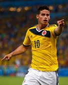 James Rodriguez of Colombia celebrates scoring his team's second goal and his second of the game during the 2014 FIFA World Cup Brazil round of 16...