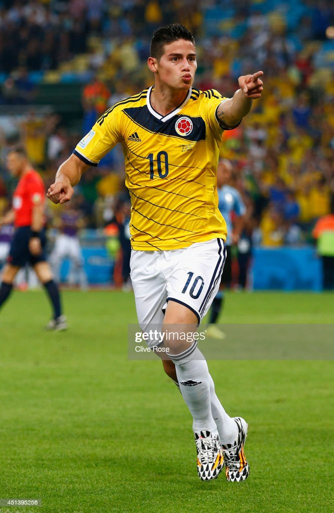 <a gi-track='captionPersonalityLinkClicked' href=/galleries/search?phrase=James+Rodriguez&family=editorial&specificpeople=4422074 ng-click='$event.stopPropagation()'>James Rodriguez</a> of Colombia celebrates scoring his team's second goal and his second of the game during the 2014 FIFA World Cup Brazil round of 16 match between Colombia and Uruguay at Maracana on June 28, 2014 in Rio de Janeiro, Brazil.