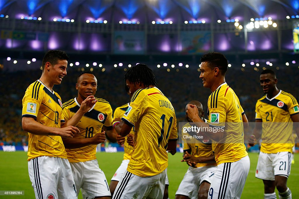 <a gi-track='captionPersonalityLinkClicked' href=/galleries/search?phrase=James+Rodriguez&family=editorial&specificpeople=4422074 ng-click='$event.stopPropagation()'>James Rodriguez</a> of Colombia (L) celebrates scoring his team's second goal and his second of the game with teammates during the 2014 FIFA World Cup Brazil round of 16 match between Colombia and Uruguay at Maracana on June 28, 2014 in Rio de Janeiro, Brazil.