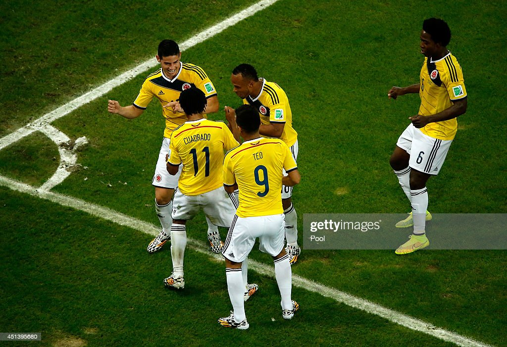 <a gi-track='captionPersonalityLinkClicked' href=/galleries/search?phrase=James+Rodriguez&family=editorial&specificpeople=4422074 ng-click='$event.stopPropagation()'>James Rodriguez</a> of Colombia celebrates scoring his team's second goal and his second of the game with teammates during the 2014 FIFA World Cup Brazil round of 16 match between Colombia and Uruguay at Maracana on June 28, 2014 in Rio de Janeiro, Brazil.