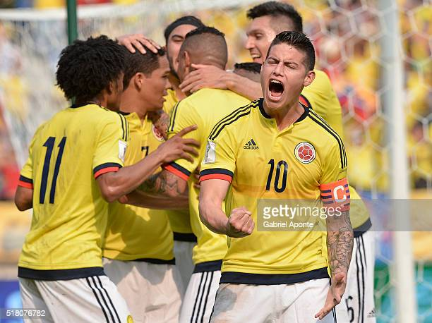 James Rodriguez of Colombia celebrates the goal of his teammate Carlos Bacca during a match between Colombia and Ecuador as part of FIFA 2018 World...