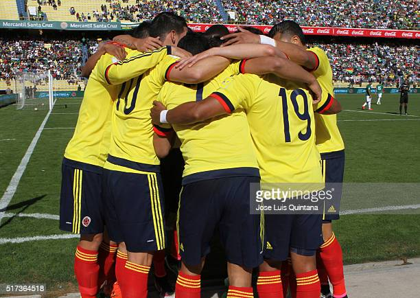 James Rodriguez of Colombia celebrates with teammates after scoring the opening goal during a match between Bolivia and Colombia as part of FIFA 2018...