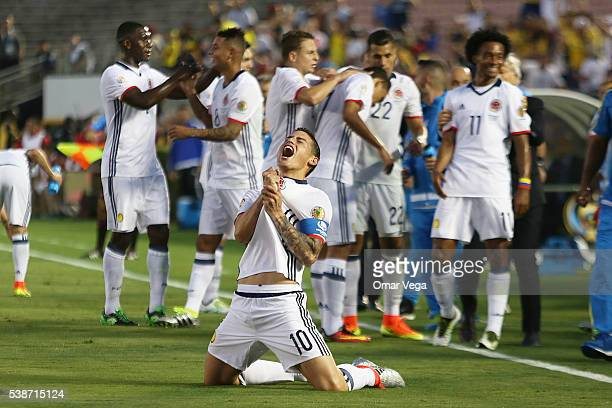 James Rodriguez of Colombia celebrates with teammates after scoring the second goal of his team during a group A match between Colombia and Paraguay...
