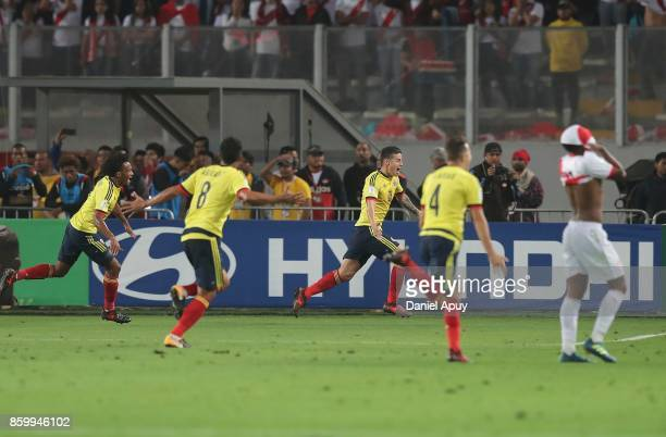 James Rodriguez of Colombia celebrates with teammates after scoring the first goal of his team during a match between Peru and Colombia as part of...