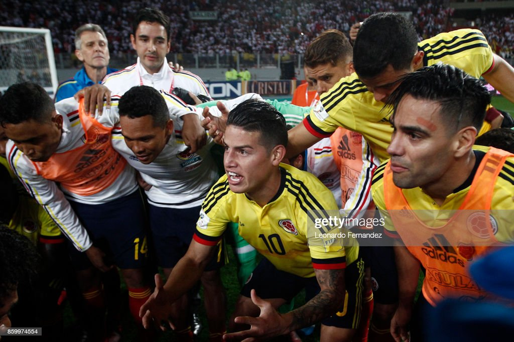 James Rodriguez of Colombia celebrates with teammates the qualifying to the World Cup Russia 2018 after a match between Peru and Colombia as part of FIFA 2018 World Cup Qualifiers at National Stadium on October 10, 2017 in Lima, Peru.