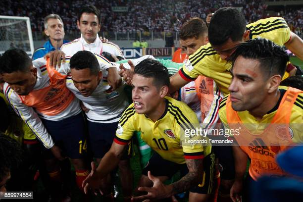James Rodriguez of Colombia celebrates with teammates the qualifying to the World Cup Russia 2018 after a match between Peru and Colombia as part of...