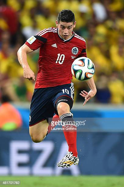 James Rodriguez of Colombia controls the ball during the 2014 FIFA World Cup Brazil Quarter Final match between Brazil and Colombia at Castelao on...