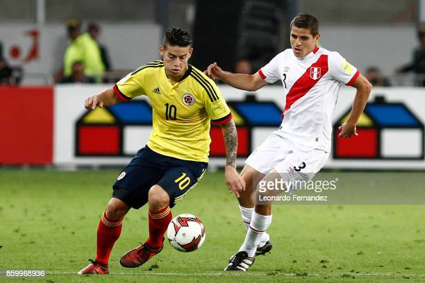 James Rodriguez of Colombia fights for the ball with Aldo Corzo of Peru during match between Peru and Colombia as part of FIFA 2018 World Cup...
