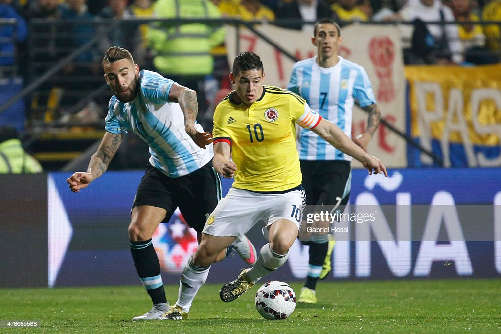 James Rodriguez of Colombia fights for the ball with Nicolas Otamendi of Argentina during the 2015 Copa America Chile quarter final match between Argentina and Colombia at Sausalito Stadium on June 26, 2015 in Viña del Mar, Chile.