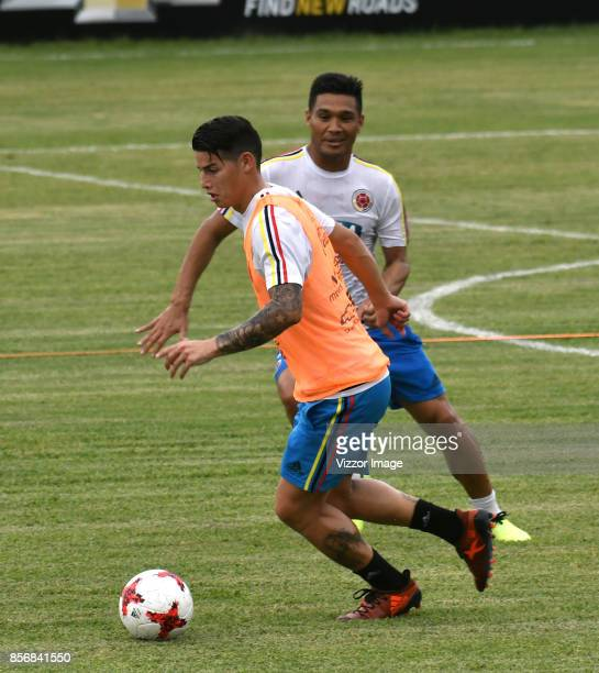 James Rodriguez of Colombia fights for the ball with teammate Carlos Bacca during a training session at Autonoma del Caribe University Sports Center...