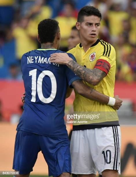 James Rodriguez of Colombia hugs with Neymar Jr of Brazil after a match between Colombia and Brazil as part of FIFA 2018 World Cup Qualifiers at...