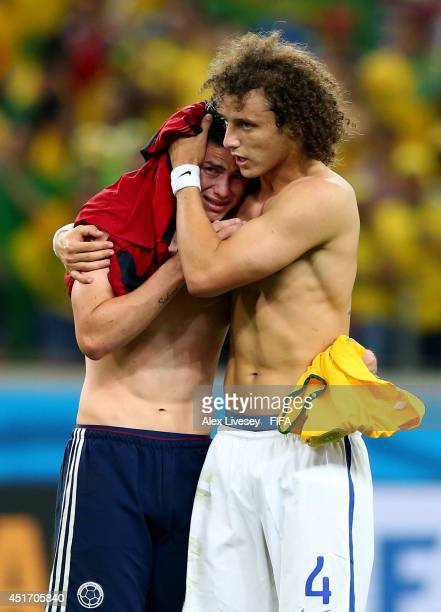 James Rodriguez of Colombia is consoled by David Luiz of Brazil after the 2014 FIFA World Cup Brazil Quarter Final match between Brazil and Colombia...