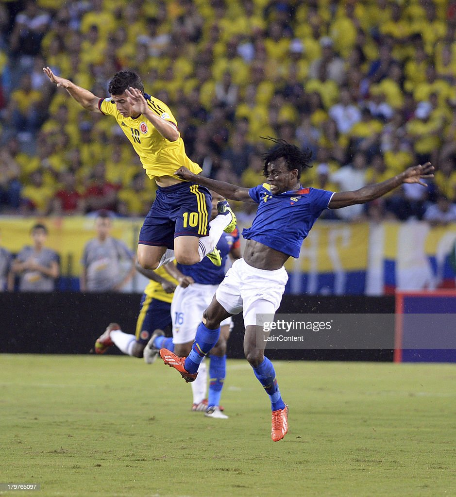 <a gi-track='captionPersonalityLinkClicked' href=/galleries/search?phrase=James+Rodriguez&family=editorial&specificpeople=4422074 ng-click='$event.stopPropagation()'>James Rodriguez</a> of Colombia jumps for the ball during a match between Colombia and Ecuador as part of the 15th round of the South American Qualifiers at Metropolitano Roberto Melendez Stadium on September 06, 2013 in Barranquilla, Colombia.