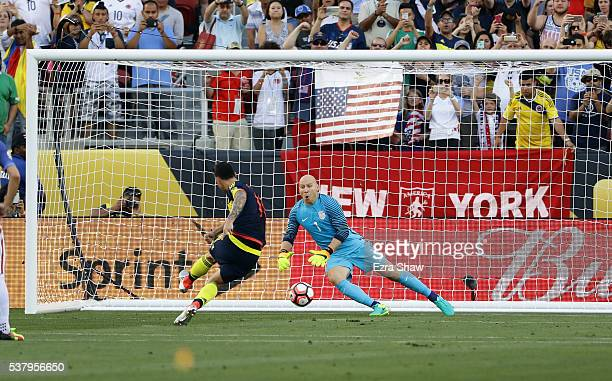James Rodriguez of Colombia scores a penalty kick on Brad Guzan of United States during the 2016 Copa America Centenario Group match between the...