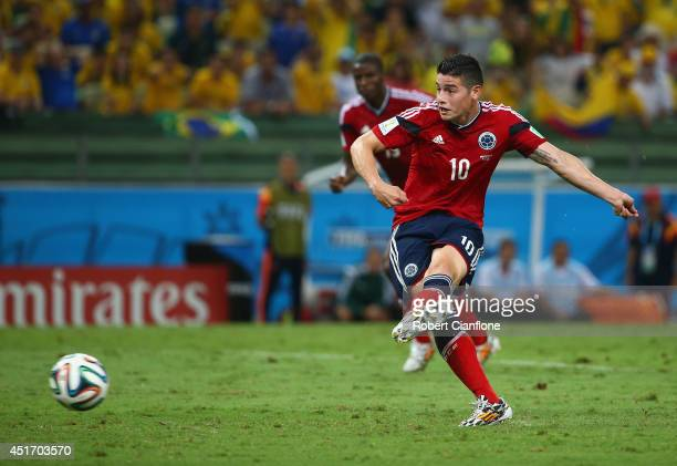 James Rodriguez of Colombia shoots and scores his team's first goal on a penalty kick during the 2014 FIFA World Cup Brazil Quarter Final match...