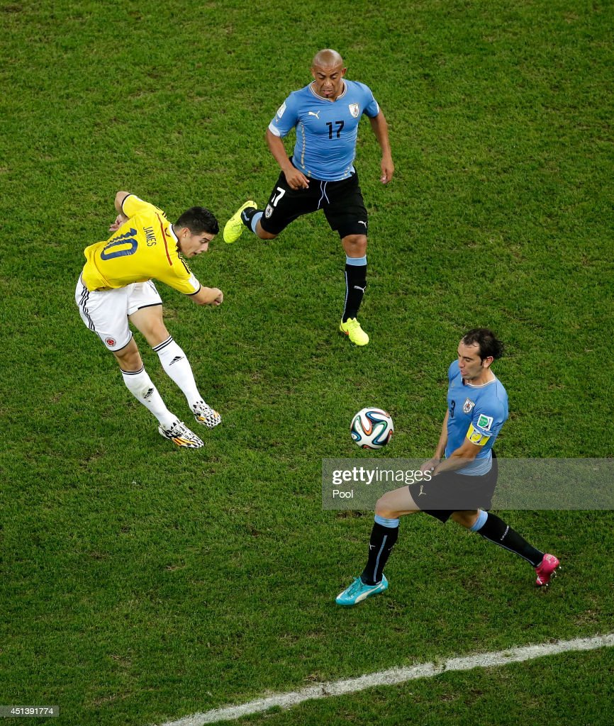 James Rodriguez of Colombia shoots and scores his team's first goal during the 2014 FIFA World Cup Brazil round of 16 match between Colombia and...