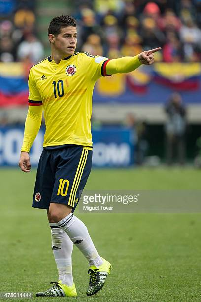 James Rodriguez of Colombia signals during the 2015 Copa America Chile Group C match between Colombia and Peru at Municipal Bicentenario Germán...
