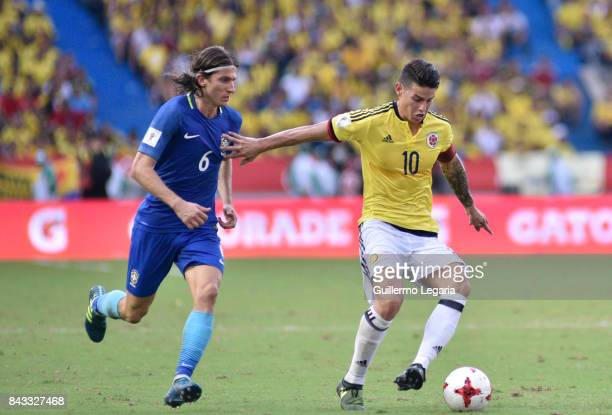 James Rodriguez of Colombia struggles for the ball with Felipe Luis of Brazil during a match between Colombia and Brazil as part of FIFA 2018 World...