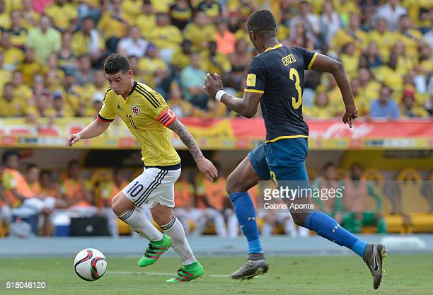 James Rodriguez of Colombia struggles for the ball with Frickson Erazo of Ecuador during a match between Colombia and Ecuador as part of FIFA 2018...