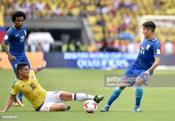 James Rodriguez of Colombia struggles for the ball with Roberto Firmino of Brazil during a match between Colombia and Brazil as part of FIFA 2018...