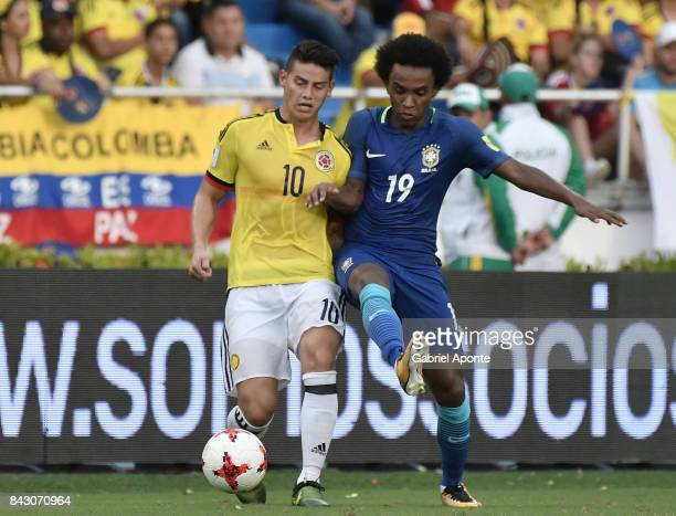 James Rodriguez of Colombia struggles for the ball with William of Brazil during a match between Colombia and Brazil as part of FIFA 2018 World Cup...