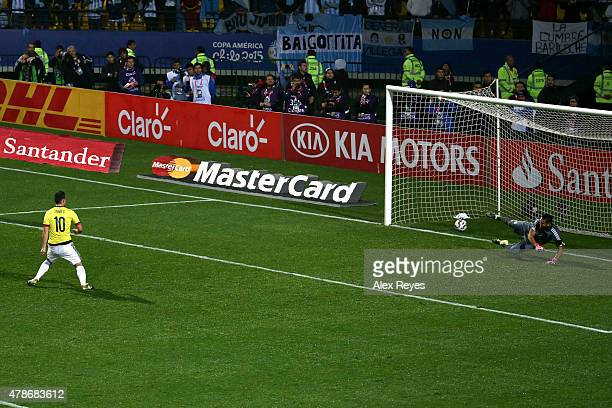 James Rodriguez of Colombia takes the first penalty kick in the penalty shootout during the 2015 Copa America Chile quarter final match between...