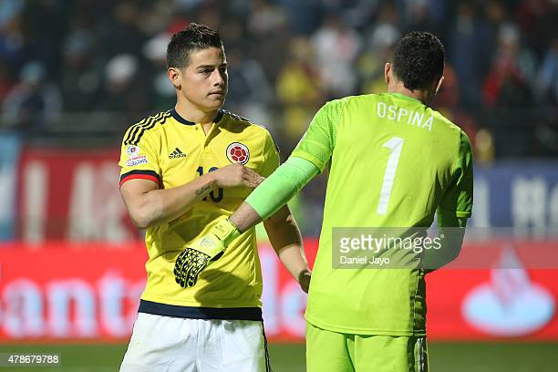 James Rodriguez of Colombia talks with David Ospina of Colombia in the penalty shootout during the 2015 Copa America Chile quarter final match...