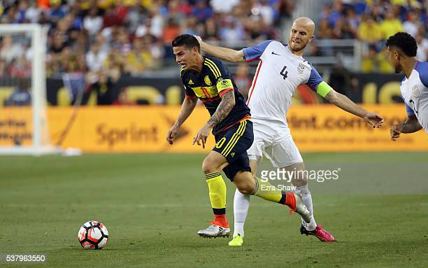 James Rodriguez of Colombia trips on Michael Bradley of United States during the 2016 Copa America Centenario Group match between the United States...