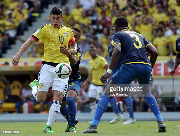 James Rodriguez of Colombia vies for the ball with Pedro Quiñ–onez of Ecuador during a match between Colombia and Ecuador as part of FIFA 2018 World...