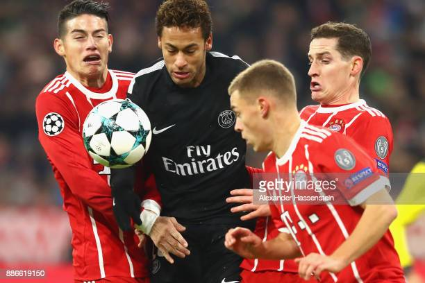 James Rodriguez of FC Bayern Muenchen battles for the ball with Neymar of PSG Paris and Joshua Kimmich and Sebastian Rudy of FC Bayern Muenchen...