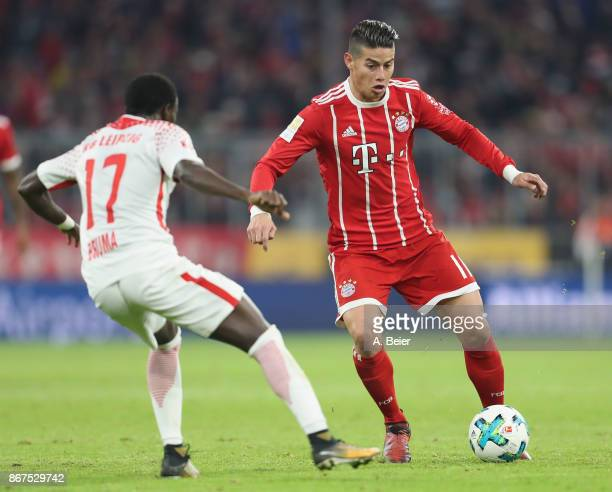 James Rodriguez of FC Bayern Muenchen fights for the ball with Bruma of RB Leipzig during the Bundesliga match between FC Bayern Muenchen and RB...