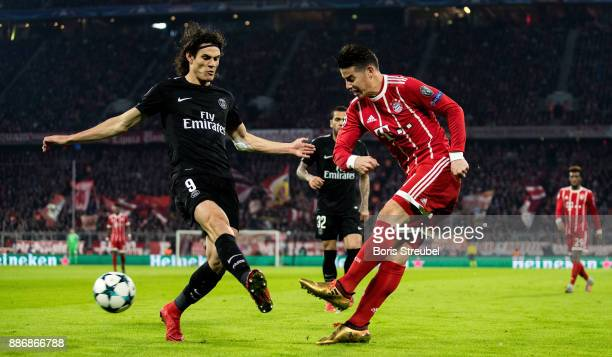 James Rodriguez of FC Bayern Muenchen is challenged by Edinson Cavani of Paris SaintGermain during the UEFA Champions League group B match between...