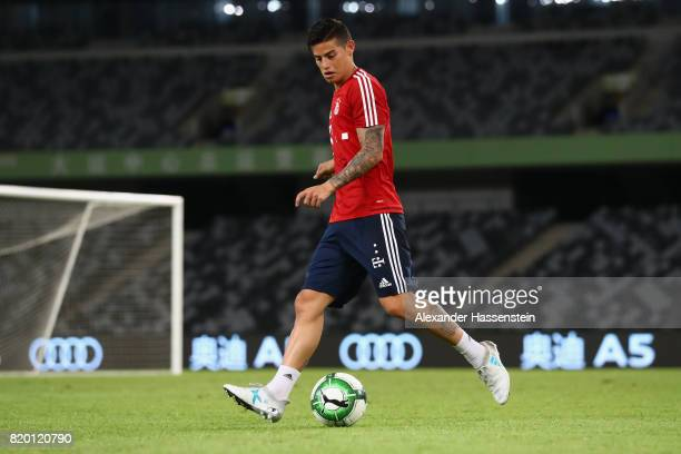 James Rodriguez of FC Bayern Muenchen plays with the ball during a training session at Shenzhen Universiade Sports Centre during the Audi Summer Tour...