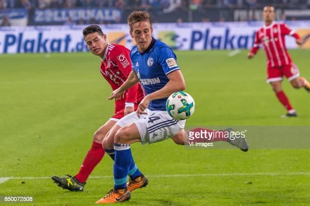 James Rodriguez of FC Bayern Munich Bastian Oczipka of FC Schalke 04 during the Bundesliga match between Schalke 04 and Bayern Munich on September 19...