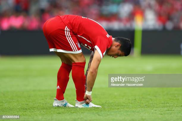 James Rodriguez of Muenchen adjust his football boots during the International Champions Cup Shenzen 2017 match between Bayern Muenchen and AC Milan...