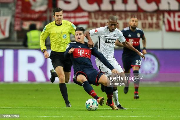 James Rodriguez of Muenchen and Gelson da Conceicao Tavares Fernandes of Frankfurt battle for the ball during the Bundesliga match between Eintracht...