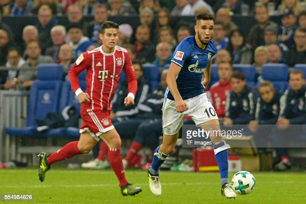James Rodriguez of Muenchen and Nabil Bentaleb of Schalke battle for the ball during the Bundesliga match between FC Schalke 04 and FC Bayern...