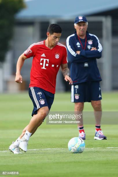 James Rodriguez of Muenchen runs with the ball next to his head coach Carlo Ancelotti during a training session at Geylang Field during the Audi...