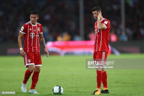 James Rodriguez of Muenchen talks to his team mate JRobert Lewandowski during the International Champions Cup Shenzen 2017 match between Bayern...