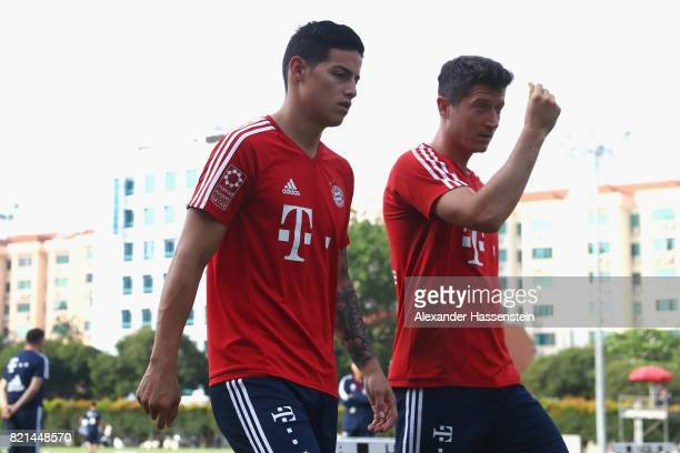 James Rodriguez of Muenchen talks to his team mate Robert Lewandowski during a training session at Geylang Field during the Audi Summer Tour 2017 on...