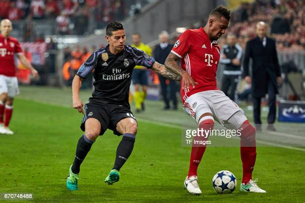 James Rodriguez of Real Madrid and Jerome Boateng of Munich battle for the ball during the UEFA Champions League Quarter Final first leg match...